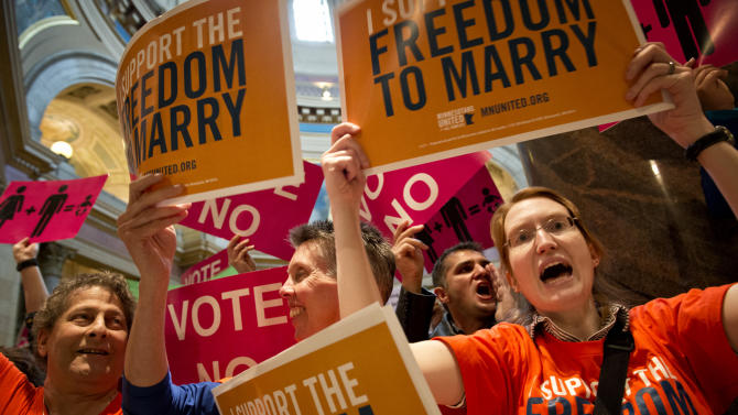 Advocates for both sides chant, sing and plead as they lined the entrance to the House floor as the House takes up the same-sex marriage bill in St. Paul, Minn., Thursday, May 9, 2013.  (AP Photo/The Star Tribune, Glen Stubbe)  MANDATORY CREDIT; ST. PAUL PIONEER PRESS OUT; MAGS OUT; TWIN CITIES TV OUT