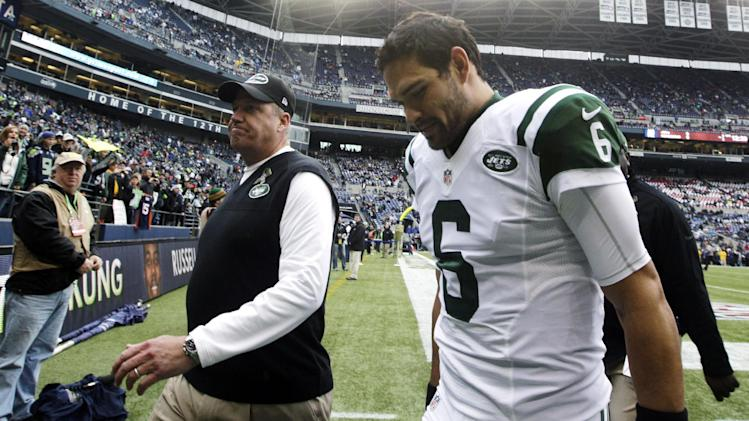New York Jets head coach Rex Ryan, left, walks off the field with quarterback Mark Sanchez (6) prior to an NFL football game against the Seattle Seahawks, Sunday, Nov. 11, 2012, in Seattle. (AP Photo/Elaine Thompson)