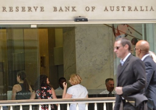 <p>People walk past the Reserve Bank of Australia office in central Sydney on November 6. Australia's central bank on Tuesday cut the official interest rate by 25 basis points to 3.0%, its lowest level since the depths of the 2009 financial crisis.</p>