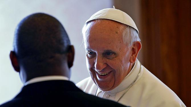 Pope Francis, right, meets with Mozambique's Prime Minister Alberto Vaquina on the occasion of their private audience in the pontiff's library, at the Vatican, Thursday, April 11, 2013. (AP Photo/Alessandro Di Meo, pool)