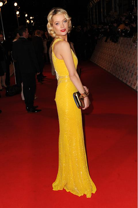 Laura Whitmore pulled off this canary yellow gown with ease. Copyright [Getty]