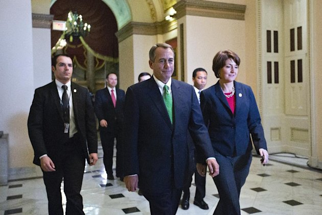 Speaker of the House John Boehner, R-Ohio, and Rep. Cathy McMorris Rodgers, R-Wash., right, the Republican Conference Chair, arrive at the House of Representatives for the final vote on emergency legislation to avoid a national &quot;fiscal cliff&quot; at the Capitol in Washington, Tuesday, Jan. 1, 2013. (AP Photo/J. Scott Applewhite)