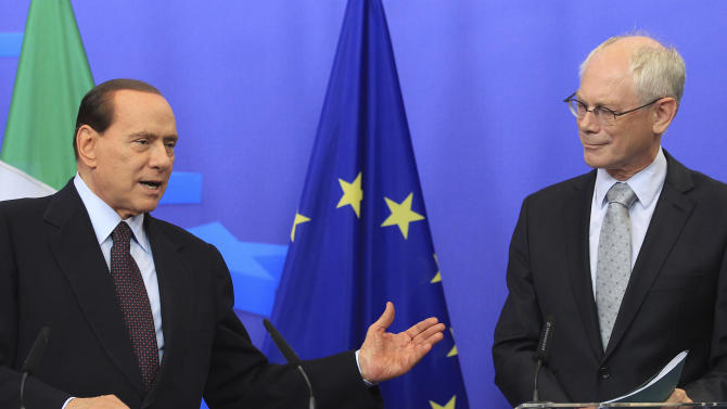 European Council President, Herman Van Rompuy, right, and Italy's Prime Minister, Silvio Berlusconi, address the media after they had a meeting at the European Council building in Brussels, Tuesday, Sept. 13, 2011. (AP Photo/Yves Logghe)