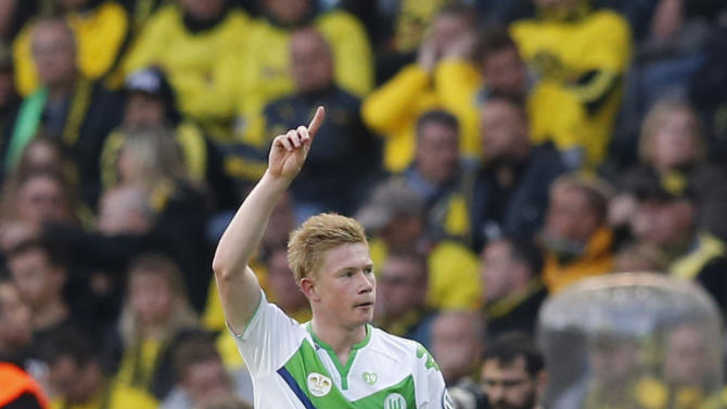 VfL Wolfsburg's De Bruyne celebrates after scoring a goal against Borussia Dortmund during their German Cup final soccer match in Berlin