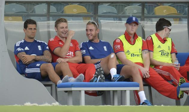 England's Wright and Broad share a joke before the second T20 international cricket match against the West Indies' in Barbados