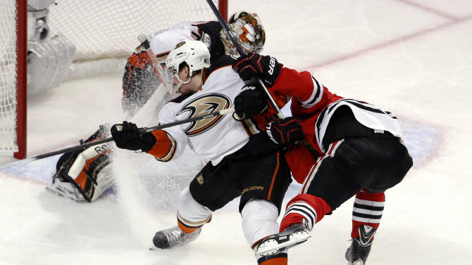Anaheim Ducks defenseman Sami Vatanen (45) checks Chicago Blackhawks center Jonathan Toews, right, during the third period in Game 4 of the Western Conference finals of the NHL hockey Stanley Cup playoffs, Saturday, May 23, 2015, in Chicago. (AP Photo/Charles Rex Arbogast)