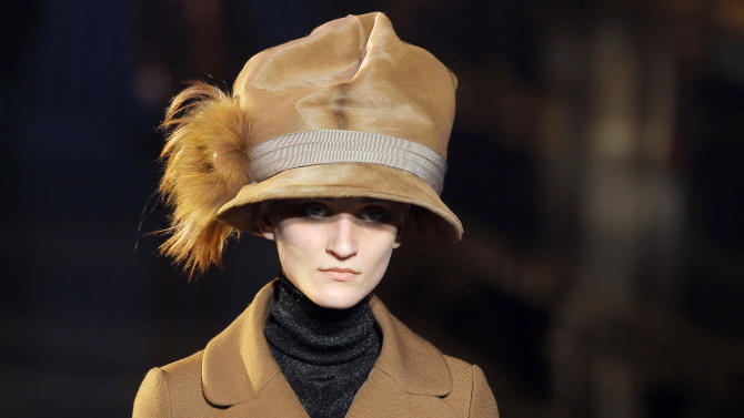 A model wears a creation by U.S fashion designer Marc Jacobs for his Louis Vuitton collection, Women's Fall-Winter, ready-to-wear 2013 during Paris Fashion week, Wednesday, March 7, 2012. (AP Photo/Jacques Brinon)