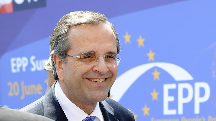 Antonis Samaras, Prime Minister of Greece arrives for a meeting of leaders of the European People's Party (EPP) in Vienna, Austria on Thursday, June 20, 2013. On the agenda will be the preparation of the European Council, scheduled for June 27 and 28. (AP Photo/Hans Punz)