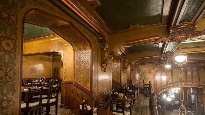 This photo taken Monday, July 31, 2014, shows the upper level of Caru cu Bere restaurant, in Bucharest, Romania. Caru cu Bere, a fabled restaurant in the Old City, has been serving cold beer, spicy sausages and a lot more since the last year of the 19th century. (AP Photo/Octav Ganea) ROMANIA OUT