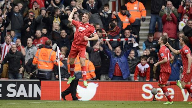 Southampton's Rickie Lambert leaps and celebrates after scoring a goal from a free kick against Chelsea during their English Premier League soccer match at St. Mary's Stadium in Southampton, England March 30, 2013 (Reuters)
