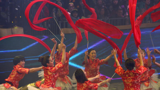 Performers take part in a night parade to celebrate Chinese New Year in Hong Kong Sunday, Feb. 10, 2013. The Lunar New Year this year marks the Year of the Snake in the Chinese calendar. (AP Photo/Vincent Yu)