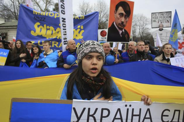 Demonstrators from Solidarity trade union take part in a rally for Ukraine in front of the Russian embassy in Warsaw