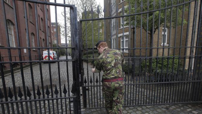 British army personnel leave residential apartments in Bow, east London, where the Ministry to Defense plans to place surface-to-air missiles during the Summer Olympics Tuesday, May 1,  2012. Trucks carrying uniformed soldiers fanned out around the London apartment block where the Ministry of Defense plans to place surface-to-air missiles during the Summer Olympics. Residents at the apartments in Bow _ about 2 miles (3.2 kilometers) from London's Olympic Stadium _ say several trucks carrying soldiers arrived Tuesday morning. (AP Photo/Lefteris Pitarakis)