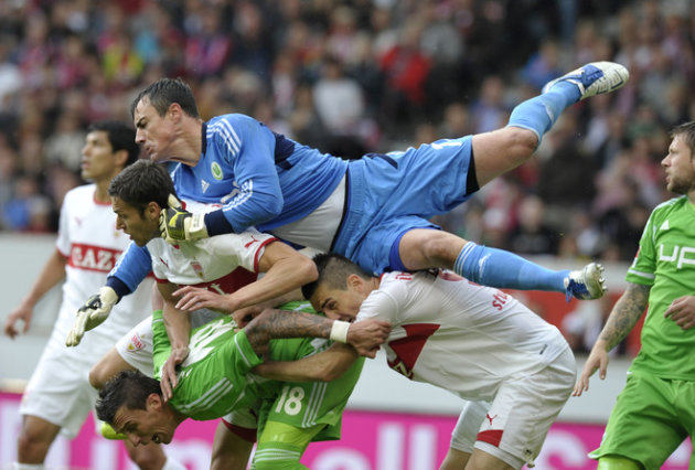 TOPSHOTS  Wolfsburg's Swiss Goalkeeper Diego Benaglio (on Top) Flies Over Stuttgart's French Defender Matthieu AFP/Getty Images