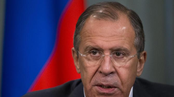 Russian Foreign Minister Sergey Lavrov speaks to the media after his talks with his Fijian counterpart Inoke Kubuabola after their meeting in Moscow, Russia, Friday, June 27, 2014.Lavrov welcomed the Ukrainian president's intention to extend a cease-fire in the east, but warned Ukraine against putting ultimatums to insurgents. (AP Photo/Alexander Zemlianichenko)
