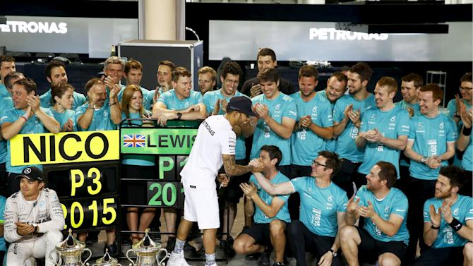 Mercedes' Formula One driver Lewis Hamilton of Britain celebrates winning the Bahrain Grand Prix with Nico Rosberg and the team in Sakhir