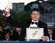 "Romanian director Cristian Mungiu poses with his Palme d'Or for Best Film prize at the Cannes film festival in 2007. This year Mungiu is back with a new film: ""Beyond the Hills"", based on a true story that unleashed a media frenzy in 2005 when a young woman, Irina Cornici, died after an exorcism session to rid her of supposed demons in the remote Tanacu monastery of eastern Romania"