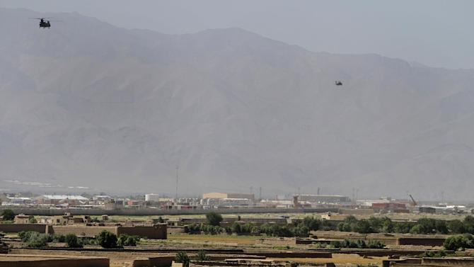 Helicopters take off from Bagram military base 50 kilometers (31 miles) north of Kabul, Afghanistan, June, 19, 2013. The Taliban claimed responsibility Wednesday for an attack in Afghanistan that killed several American troops just hours after the insurgent group announced it would hold talks with the U.S. on finding a political solution to ending the nearly 12-year war in the country.(AP Photo/Ahmad Jamshid)
