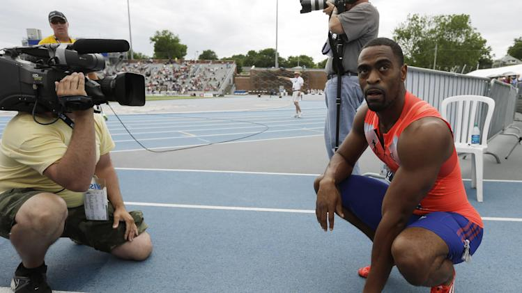 Tyson Gay reacts after winning the senior men's 200-meter dash finals at the U.S. Championships athletics meet on Sunday, June 23, 2013, in Des Moines, Iowa. Gay won the race in 19.74 seconds. (AP Photo/Charlie Neibergall)