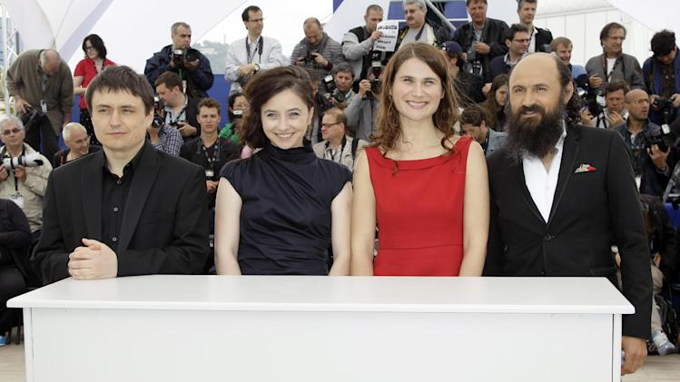 From left, director Director Christian Mungiu, actors Cosmina Stratan, Christina Flutur and Valeriu Andriuta pose during a photo call for Beyond the Hills at the 65th international film festival, in Cannes, southern France, Saturday, May 19, 2012. (AP Photo/Francois Mori)