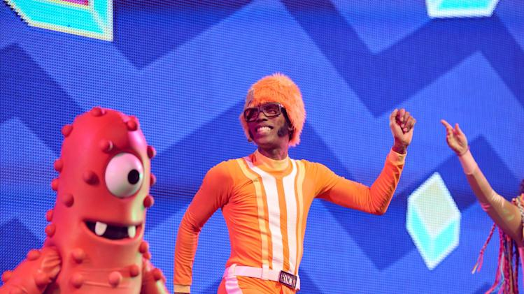 DJ Lance Rock, right, and Muno perform onstage at Yo Gabba Gabba! Live!: Get The Sillies Out! 50+ city tour kick-off performance on Thanksgiving weekend at Nokia Theatre L.A. Live on Friday Nov. 23, 2012 in Los Angeles. (Photo by John Shearer/Invision for GabbaCaDabra, LLC./AP Images)
