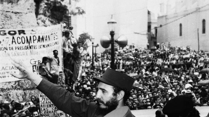 In this March 22, 1959, file photo, Fidel Castro, Cuba's Prime Minister, salutes the crowd at labor rally supporting him in Havana. Causes across the political spectrum have long used distinctive salutes to identify themselves. When Anders Behring Breivik, the far-right suspect in the massacre of 77 people in Norway,  pulled his right hand to his chest and then thrust his arm out with a clenched fist after an Oslo courtroom guard removed his handcuffs on Monday, April 16, 2012; it was hardly the first time such a salute has been flashed. (AP Photo/File)