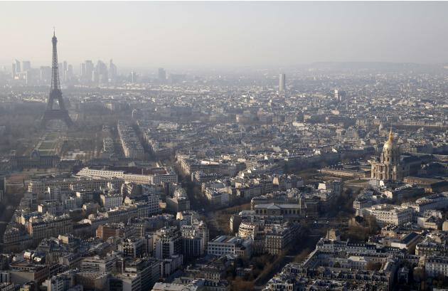 A general view of the Eiffel tower and La Defense business district skyline in the background as warm and sunny weather continues in France