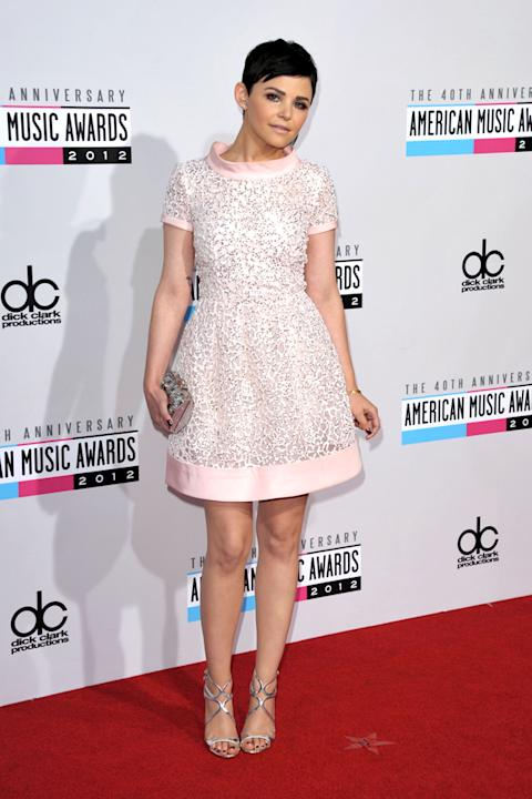 AMAs 2012: Actress Ginnifer Goodwin gives us a lesson in girly fashion, by rocking this cute pale pink prom dress with embellishment. The dark eye makeup off-sets the sweetness. We love. Copyright [PA