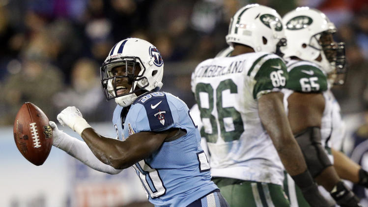 Tennessee Titans cornerback Jason McCourty (30) celebrates after intercepting a pass from New York Jets quarterback Mark Sanchez, not shown, intended for tight end Jeff Cumberland (86) in the third quarter of an NFL football game, Monday, Dec. 17, 2012, in Nashville, Tenn. Jets' Brandon Moore (65) walks off the field. (AP Photo/Wade Payne)