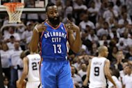 SAN ANTONIO, TX - JUNE 04:  James Harden #13 of the Oklahoma City Thunder hitting a three point late in the fourth quarter against the San Antonio Spurs in Game Five of the Western Conference Finals of the 2012 NBA Playoffs at AT&T Center on June 4, 2012 in San Antonio, Texas. NOTE TO USER: User expressly acknowledges and agrees that, by downloading and or using this photograph, user is consenting to the terms and conditions of the Getty Images License Agreement.  (Photo by Ronald Martinez/Getty Images)