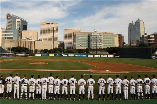 Rice players stand for the national anthem before facing Arkansas in an NCAA college baseball tournament regional game Saturday, June 2, 2012, in Houston. Arkansas won 1-0. (AP Photo/Houston Chronicle, Smiley N. Pool)