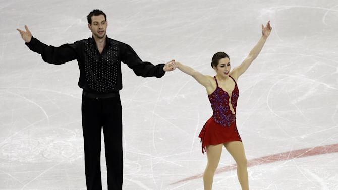 Marissa Castelli and Simon Shnapir react after competing in the senior pairs free skate program at the U.S. figure skating championships, Saturday, Jan. 26, 2013, in Omaha, Neb. (AP Photo/Charlie Neibergall)