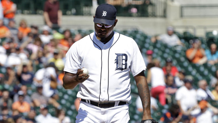 Detroit Tigers pitcher Jose Valverde looks at a ball after giving up a two-run home run to Baltimore Orioles' Chris Davis in the ninth inning of a baseball game in Detroit, Wednesday, June 19, 2013. Baltimore won 13-3. (AP Photo/Paul Sancya)