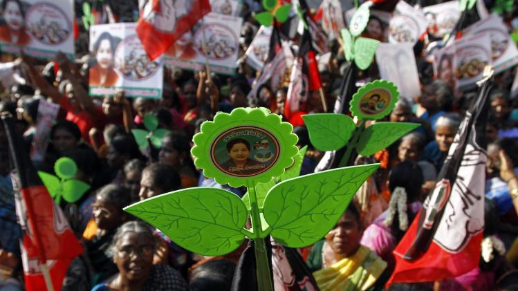 Supporters of AIADMK hold party's election symbol as they attend an election campaign rally addressed by Jayalalithaa, chief minister of India's Tamil Nadu state and chief of AIADMK, in Chennai