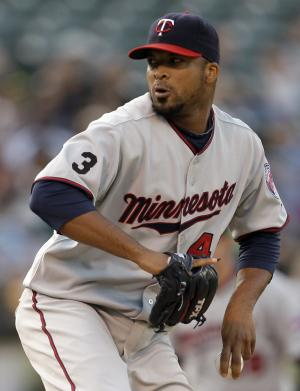Minnesota Twins' Francisco Liriano works against the Oakland Athletics during the first inning of a baseball game Friday, July 29, 2011, in Oakland, Calif. (AP Photo/Ben Margot)