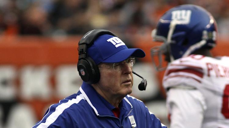 New York Giants head coach Tom Coughlin stands on the sidelines in the second half of an NFL football game against the Cincinnati Bengals, Sunday, Nov. 11, 2012, in Cincinnati. Cincinnati won 31-13. (AP Photo/Tom Uhlman)