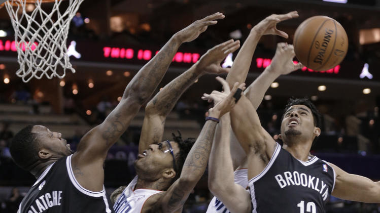 Jefferson, Bobcats power past Nets in OT, 116-111