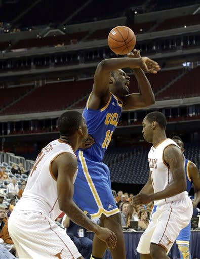 Adams helps UCLA rally past Texas 65-63