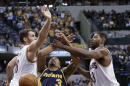 Indiana Pacers guard George Hill, center, is fouled by Cleveland Cavaliers center Tristan Thompson, right, during the second half of an NBA basketball game in Indianapolis, Friday, Feb. 27, 2015. The Pacers won 93-86. (AP Photo/AJ Mast)