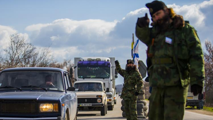 Zivkovic and Malisic, members of the Serbian Chetnik paramilitary group, direct traffic at a checkpoint on the highway between Simferopol and Sevastopol
