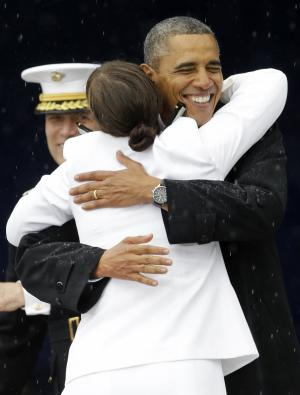 President Barack Obama congratulates Alexis Marisa Werner with open arms during the United States Naval Academy commencement ceremony in Annapolis, Md., Friday, May 24, 2013.  (AP Photo/Patrick Semansky)