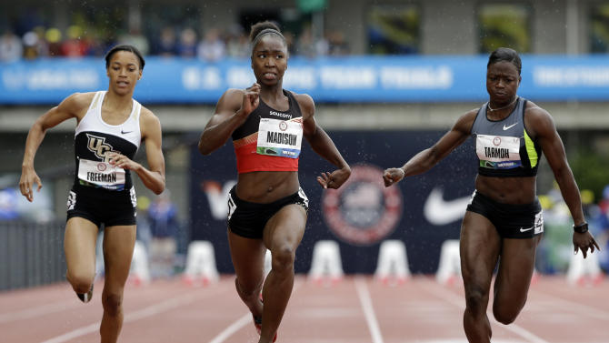 Octavious Freeman, Tianna Madison and Jeneba Tarmoh compete in the women's 100m at the U.S. Olympic Track and Field Trials Saturday, June 23, 2012, in Eugene, Ore. (AP Photo/Eric Gay)