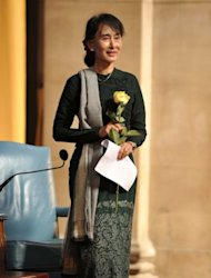 &lt;p&gt;Aung San Suu Kyi, Myanmar&#39;s Member of Parliament, holds a yellow rose given to her by Lee C.Bollinger, Columbia University&#39;s president, at Columbia University&#39;s Low Library in New York, on September 22. The Nobel laureate has been received with acclaim in the US receiving the Congressional Gold Medal, the top honor bestowed by the legislature.&lt;/p&gt;