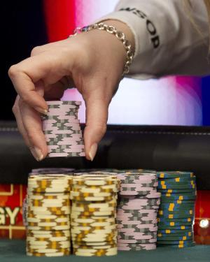 A dealer arranges chips in preparation for play at the final table of the World Series of Poker, Sunday, Nov. 6, 2011, in Las Vegas. (AP Photo/Julie Jacobson)