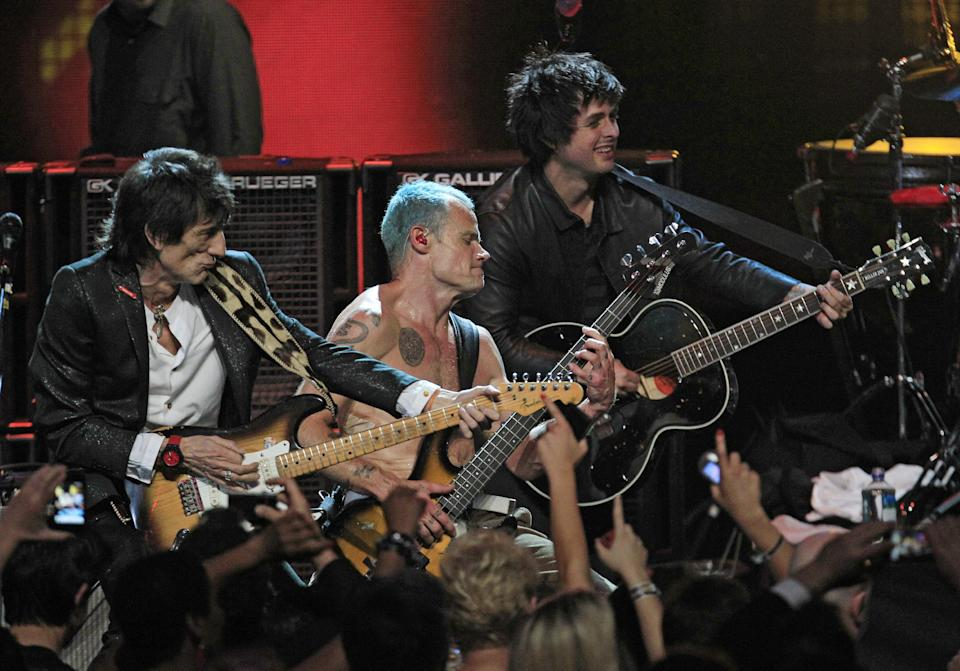 "Ronnie Wood, left, Mike ""Flea"" Balazary, center, and Billy Joe Armstrong perform in the finale of the 2012 Rock and Roll Hall of Fame inductions Sunday, April 15, 2012, in Cleveland. (AP Photo/Tony Dejak)"