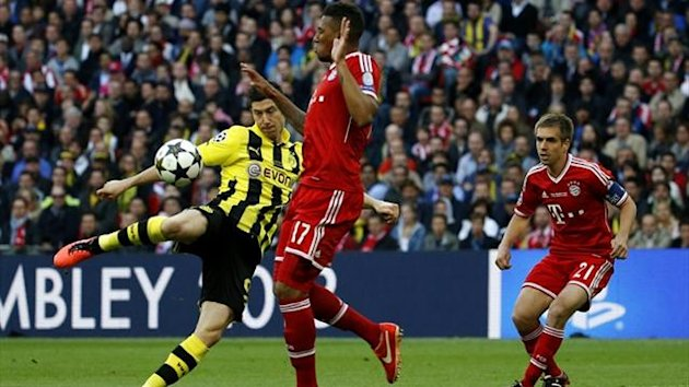 Borussia Dortmund striker Robert Lewandowski has a shot during the Champions League final against Bayern Munich (Reuters)