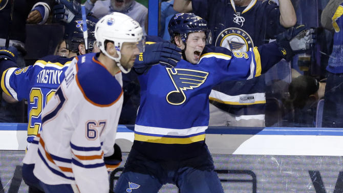 St. Louis Blues' Vladimir Tarasenko, of Russia, celebrates after scoring as Edmonton Oilers' Benoit Pouliot (67) skates past during the second period of an NHL hockey game Thursday, Oct. 8, 2015, in St. Louis. (AP Photo/Jeff Roberson)