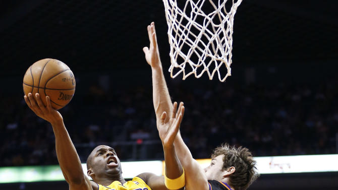 Los Angeles Lakers' Jodie Meeks (20) goes up for a shot against Phoenix Suns' Goran Dragic (1), of Slovenia, in the first half of an NBA basketball game on Monday, March 18, 2013, in Phoenix. (AP Photo/Ross D. Franklin)