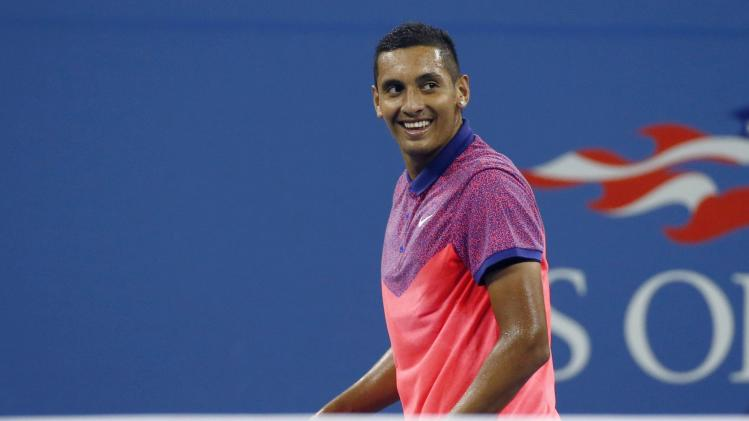 Nick Kyrgios of Australia smiles after winning a game against Tommy Robredo of Spain during their men's singles match at the 2014 U.S. Open tennis tournament in New York