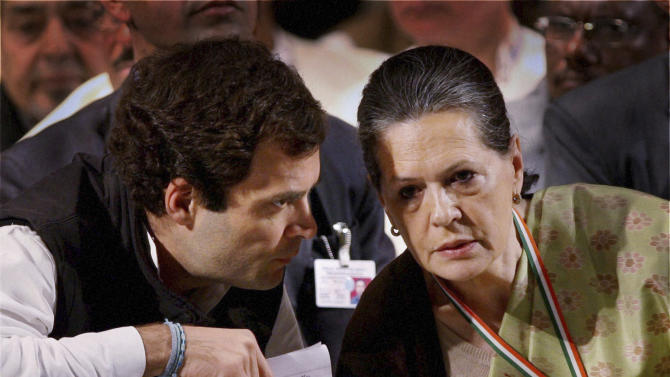 India's Congress party leader Rahul Gandhi, left, talks to his mother and party president Sonia Gandhi at a meeting of the party in Jaipur, India, Sunday, Jan. 20, 2013. Rahul Gandhi, the scion of India's Nehru-Gandhi political dynasty, was Saturday appointed the party vice president. The elevation positions him to lead the party, which his family has long dominated, in parliamentary elections next year.(AP Photo)